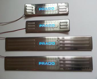 Накладки на пороги с подсветкой внутрисалонные LC150 (нержавеющая сталь)