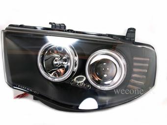 Фары передние линзовые с ангельскими глазками L200 2005-